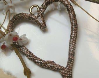 pretty faux leather heart pendant