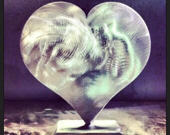 HEART POUNDING stainless steel sculpture
