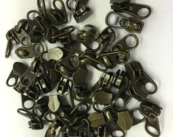 AM020- Antique Brass Look Zipper pulls.  50 ct.