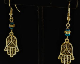 Hamsa hands with blue crystals on stainless steel