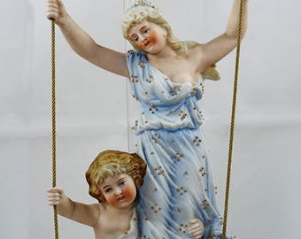 Antique German Bisque Figurines on a Swing