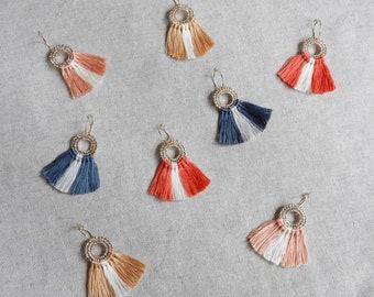 Gilded hoop earrings with cotton tassels