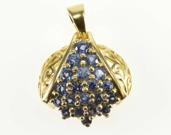 10k Tanzanite Encrusted Ornate Scroll Design Round Pendant Gold