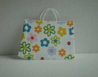 Cut shopping bag made of paper flowers for scrapbooking and card