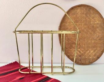 vintage brass magazine rack or holder wire cage
