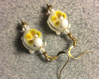 Yellow lampwork turtle bead earrings adorned with clear Czech glass beads.
