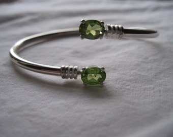 STERLING SILVER OPEN BANGLE BRACELET WITH PAIR 8MM X 6MM OVAL PERIDOT SIZE S-M