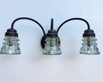 Beautiful 3-light Oil-rubbed Bronze Vanity Fixture with Arching Stems and Choice of Vintage Glass Insulators