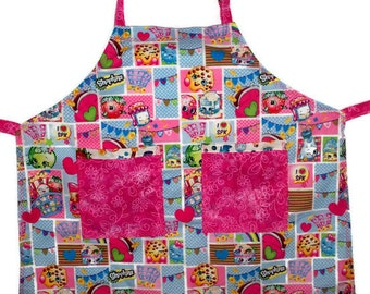 Small Childs Girls Apron in Shopkins in multi-color print and pink cotton fabrics