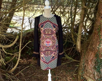 Vibrant patterned and embellished body con dress
