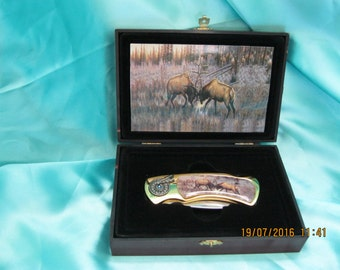 Vintage Leader 3 inch folding  single blade hunting Knife with fighting elk with  case never used
