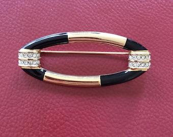 Oval brooch - black enamel, gold metal and glass rhinestones - 1970's