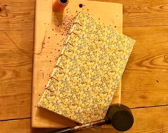 Jump into spring with this floral and lemon yellow coptic stitch journal