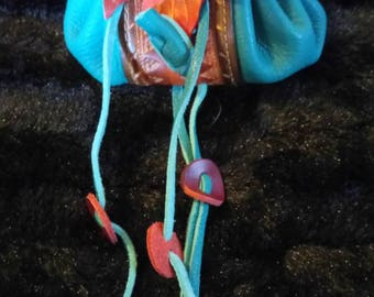 Purse rust leather and turquoise leaf pattern
