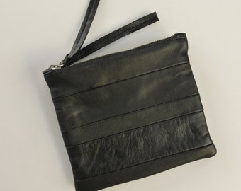 Black striped double zip pouch. Repurposed black leather, silver zippers, fully lined.