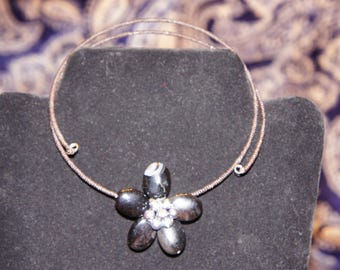 Single flower in black or turquoise torc
