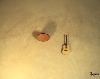 Miniature guitar made of basswood.  (No. MG25)
