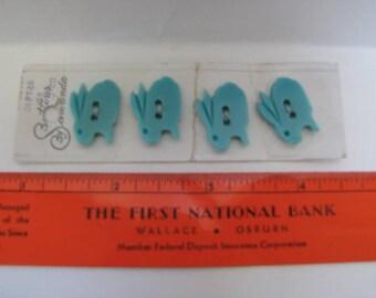 Four teal bunny/rabbit buttons