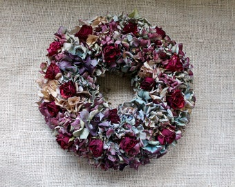 Table decorations - hydrangea wreath in blue and red and pale rose - wall decoration