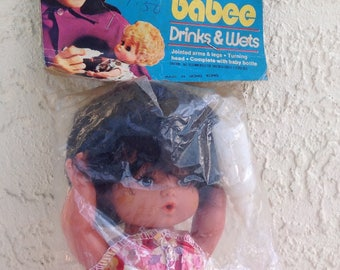 1970s Bottle BABEE baby Doll bagged retro header card drinks wets 70's look Mod fashion Hong Kong Dime Corner Store five & dime rooted hair