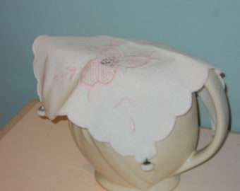 Pitcher cover made from vintage linen doily and vintage glass buttons