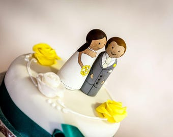 Personalised bride and groom peg doll wedding cake toppers