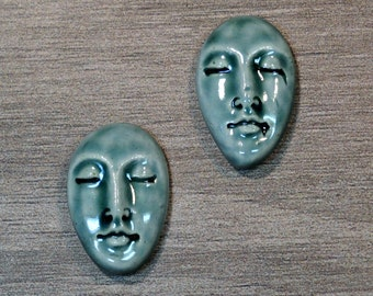 Pair of Two Medium Almond Ceramic Face Stone Cabochons in Peacock