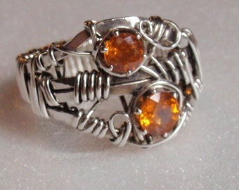 Sale Price 225.  Mandarin Garnet- JANUARY BIRTHSTONE set on a forged sterling bandand wrapped securely for a bold statement ring.  Size 8