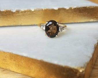 10x8mm Oval Smoky Quartz and White Topaz Accent Sterling Silver Ring Size 6.5