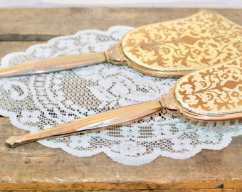 Two Toned Metal Hand Held Long Mirror with Gold Floral Decor and Matching Hair Brush