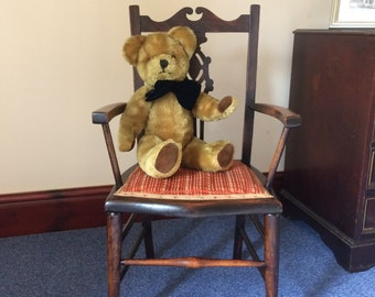 Child's wooden armchair with upholstered seat