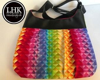 Rainbow crossbody bag purse with black faux leather trim