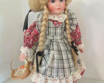 Vintage porcelain pigtailed blond hair blue eyed doll 15 inch flowered and plaid dress and straw hat  no markings used