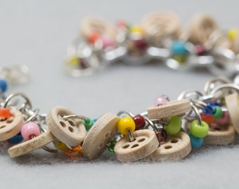 Button Charm Bracelet / Wooden Buttons With Rainbow Beads / Fun Multicolored Rainbow Meets Neutral Jewelry by randomcreative on Etsy