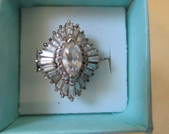Vintage ring silver toned with waving clear crystal center stones and clear rondels rhinestones ,size 6 1/2 no markings