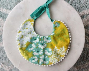 Green and Teal Drool Bib with Pom Pom Fringe