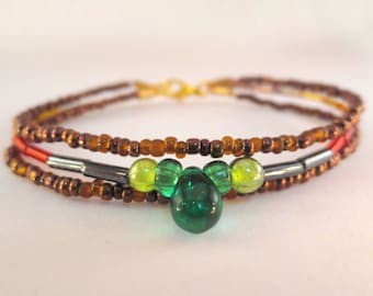 Multi layer bracelet with green drop