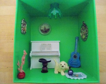 Hand made diorama with puppy and musical instruments