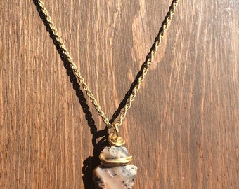 Arrowhead stone on a 30 inch stone