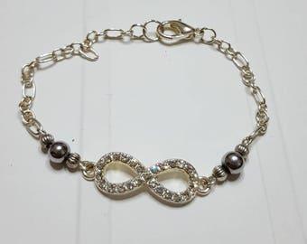 Infinity bracelet, rhinestone and silver Hematite