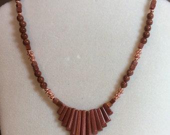 Goldstone and copper bib necklace