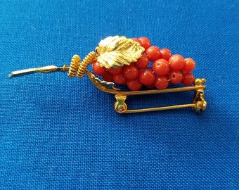 Victorian coral colored grape brooch marked 800
