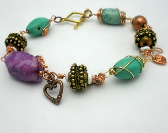 Handcrafted Bracelet - Boho Tribal Style - wire wrapped beads of purple turquoise Jade - rustic wire copper heart and bow charms - 8 inch
