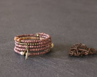 Cuff ethnic memory MULTISTRAND wrap, purple and bronze beads coco, Horn, seeds, charms