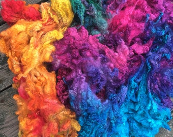 Fiber for spinning or felting dyed locks and curls in 'Electric Unicorn'