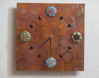 Handmade copper wall clock with ceramic cabinet knobs.