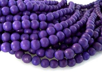 Perles rondes en bois naturel teint violet 10mm - 40 unités