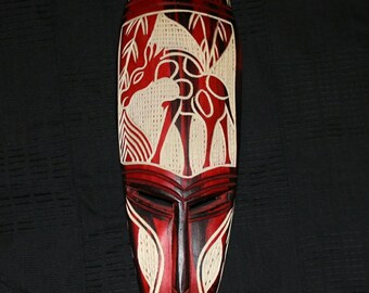African mask, hand carved with two-tone finish.