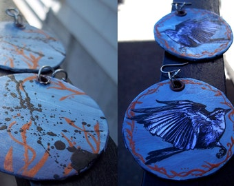 Eye on the Sparrow - hand-painted bird earrings in pale blue with metallic copper floral frame