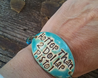 hotter than a 2 dollar pistol pottery and beaded bracelet, one of a kind, cow girl jewelry, top selling jewelry